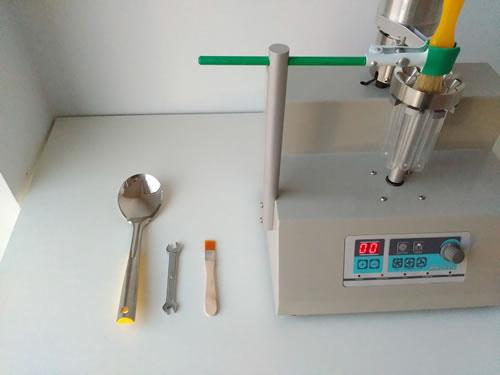 2001-9 试管在旋转分样器工作过程中起着什么作用?